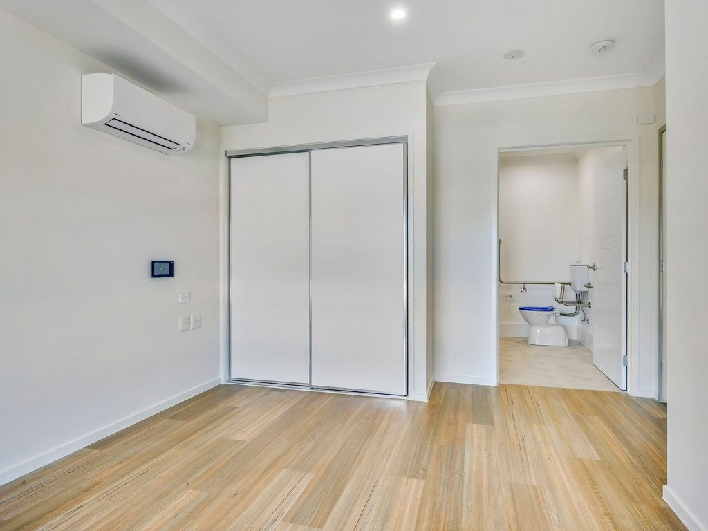 bedroom with view of accessible bathroom
