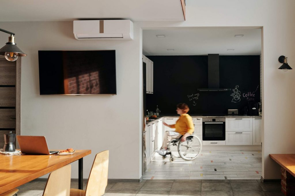 person on wheelchair in kitchen living room